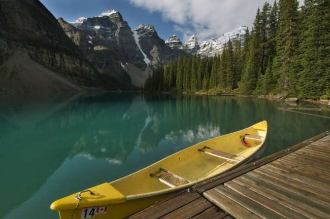 Canoe parked at a dock along Moraine Lake, Banff National Park, Banff, Canada