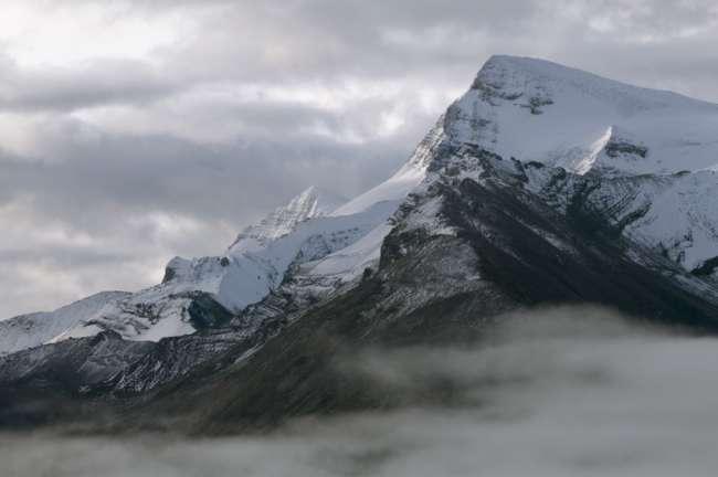 Snow covered peaks along the shore of Maligne lake, Jasper National Park, Jasper, Canada