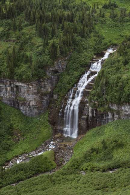 Waterfall in a valley, Waterton Glacier International Peace Park, USA - Canada