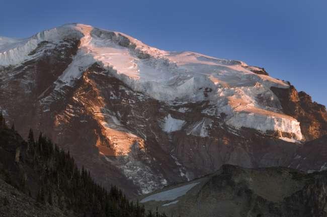 Alpine glow around the peak of Mount Rainier National Park, Washington, USA