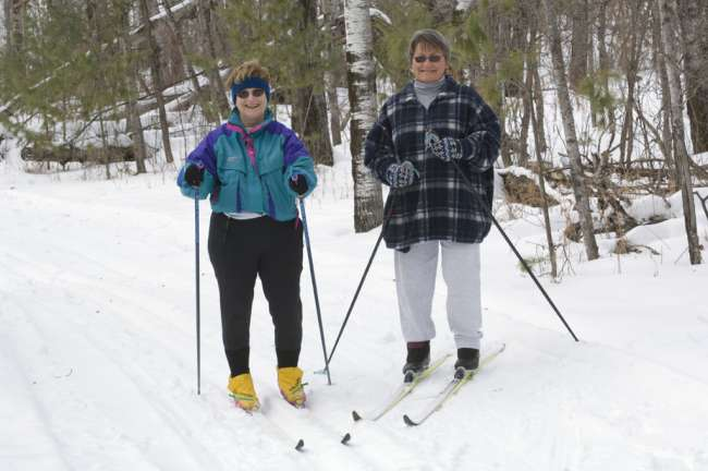 Cross Country skiers, Black Bay ski trail, Rainy Lake, Voyageurs National Park, Minnesota, USA