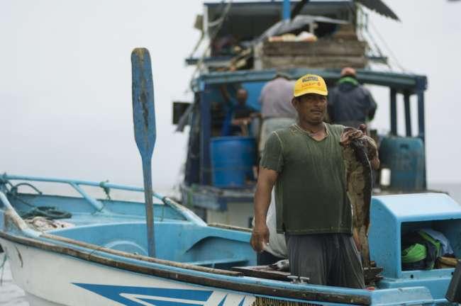 Fisherman at sea, Galapagos National Park, Ecuador