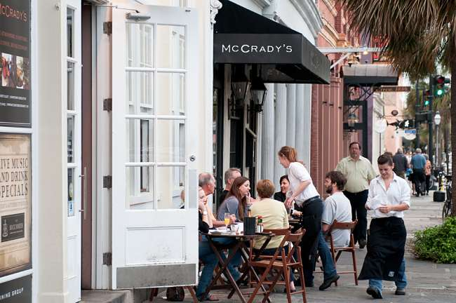 Charleston, South Carolina, USA.  Dinners enjoy a meal at McGrady's in downtown Charleston.